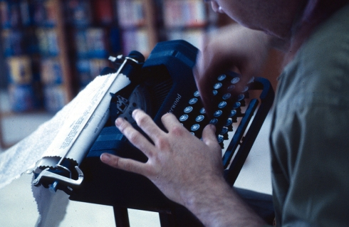Man at typewriter